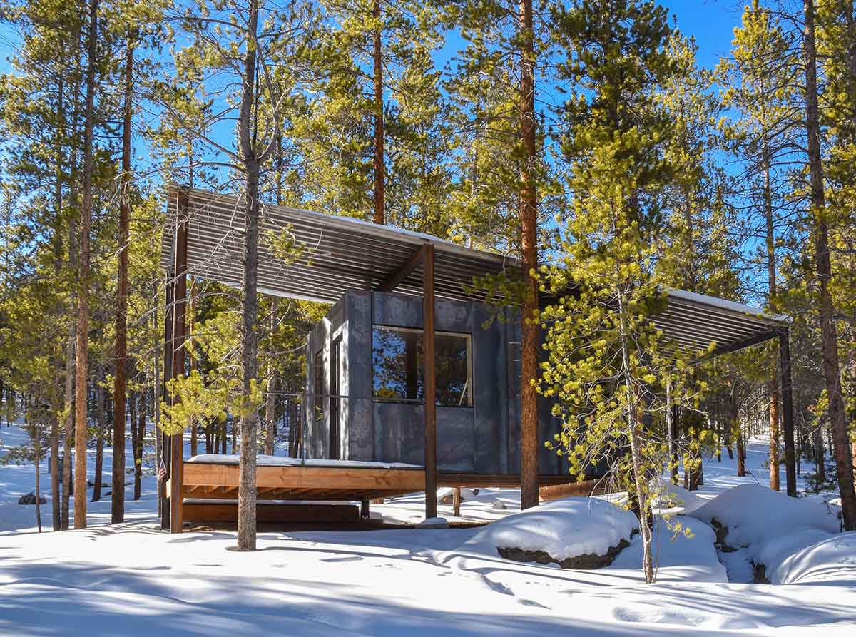 Steel clad cabin in a snowy forest