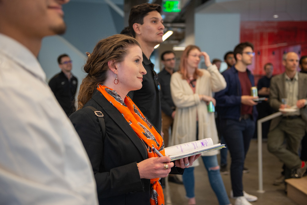 A student listening to a presentation at a firm tour