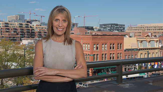 Dean Ellin with Larimer Square in the background